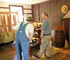 Pleasant Hill Shaker Village's Broom Maker Explaining the Proces to EAIA Member Mike Urness