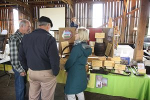 Tom and Betty Densmore Viewing Ron Quern's Display at the 2016 EAIA Annual Meeting at Pleasant Hill Shaker Village, May 2016