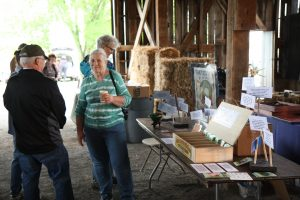 Alice and Bob Roemer Reviewing Denise and Rodney Richer's Display on Shaker Seeds at the 2016 EAIA Annual Meeting at Pleasant Hill Shaker Village