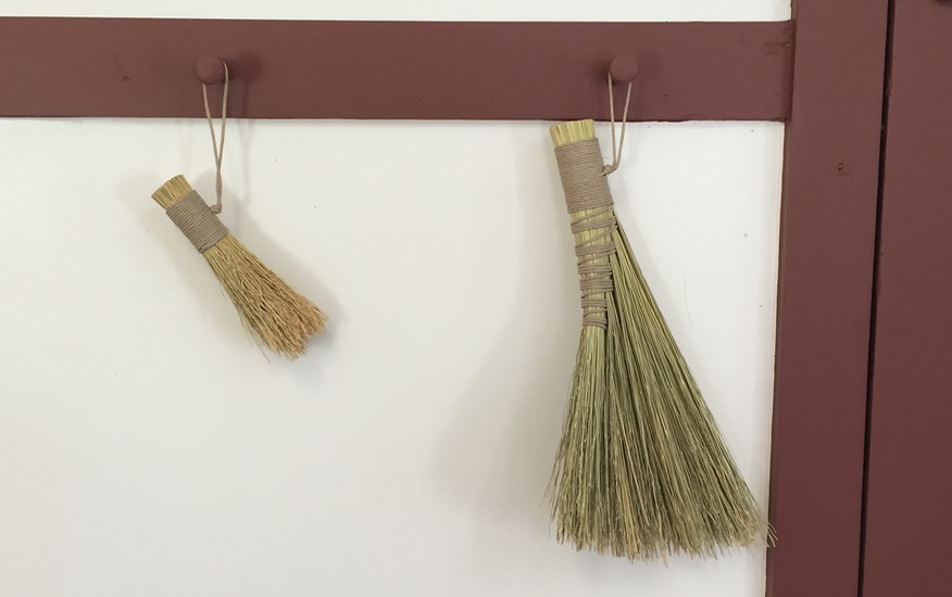 Lint brush left, turkey wing broom right -- Featured Image