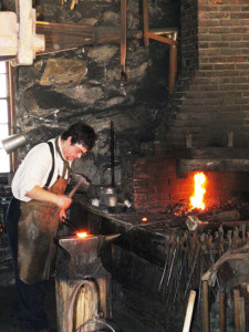 Blacksmith at the Moses Wilder Blacksmith Shop forge