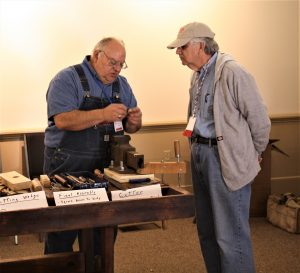 Chuck Andrews Showing Richard Cunningham How to Make a Croze During the Saturday Morning Demonstrations During the 2017 EAIA Annual Meeting at Old Sturbridge Village
