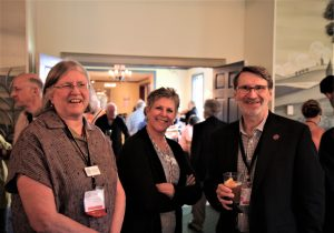Norm Abram Chats with EAIA Members Pam Howard and Gwenn Lasswell During the EAIA Silent Auction